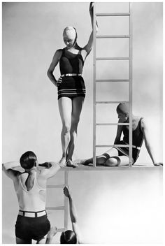Original caption:Two men wearing bathing suits (jersey tank tops and belted trunks) climbing up ladder toward two models (the one standing on the left is Georgia Graves) wearing belted one-piece je...