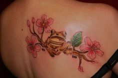 Pink Flowers And Frog Tattoo On Back