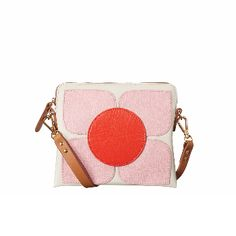 Orla Kiely Square Poppy Bag in Cream: Cream background with contrasting flowers on each side. Reverse side has yellow petals with green circle.  Square Flower applique structured poppy bag. Contrast leather detachable shoulder strap. Inside details include sand Linear Stem jacquard lining and slip pocket.  This product is made from high quality leather. This leather will develop a rich patina as it is polished and cherished.