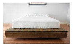 'Allen's Bed' - reclaimed wooden bed base from the 'Queens Wharf Collection' by the Canadian Salvaged Timber Company. Photo Credit: Simon Lee. #plocomiUpcycle
