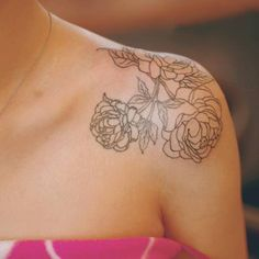 Shoulder tattoo of three peonies by Seoeon. Tattoo Artist: Seoeon