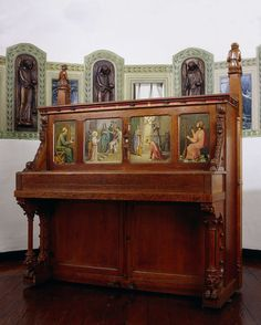 Music cabinet and piano. Oak and pine; painted scenes of St Cecilia, Hucbald, Pythagoras, Mary, angels and saints; a relic of St Cecilia behind glass in the centre; adorning the top angles, two figures playing the flute and the zither (they bear the face of the artist Cuypers and his wife Antoinette). By Pierre Joseph Hubert Cuypers, 1859 (piano signed by Th. Brugman), Rijksmuseum