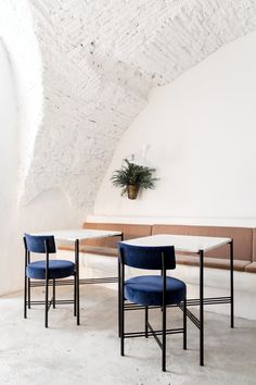 """The vaulted brick ceilings are original to the space, newly """"smoothed out"""" by the architects."""