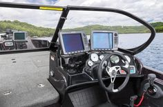 Dual consoles w/Lowrance® HDS-7 fishfinder w/GPS, port glove box & space for extra electronics