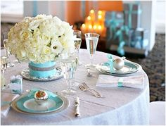 love this elegant table setting! The use of the Tiffany blue color ribbon on the napkins and ornaments is simple yet so sophisticated.