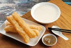 Youtiao: a savory doughnut (or carb sandwich) served with hot soy milk. (Click through for a recipe!)