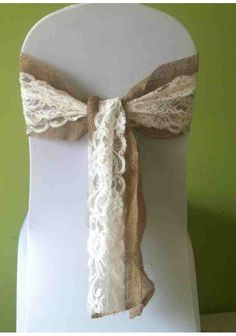 beautiful lace and hessian chair covers! (http://www.trulyscrumptiousweddings.co.uk/chair-covers.php)