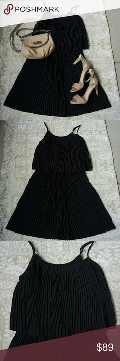 Vince Camuto Black Cocktail Dress Gorgeous pleated black cocktail dress. Has adjustable straps and an elastic waitband underneath the top. Beautiful for a cocktail party or wedding. Bag and shoes also for sale in my closet. Vince Camuto Dresses Mini