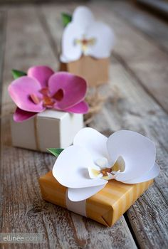 DIY Paper Orchid Flowers - Great instructions, and she includes the colored printables! Just print, cut out flower petals, glue and you're done!  Beautiful on a gift package for a wedding, or made up into long strings of orchid flowers that will move in the breeze.