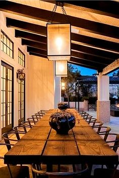 A long wooden dining room table perfect for an outdoor summer party straight from Kylie Jenner's Calabasas, California home.