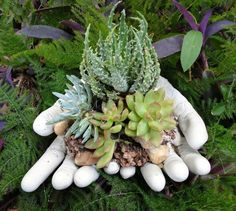 s 13 planter ideas that blow all other planters out of the water, container gardening, gardening, repurposing upcycling, Make concrete hands to hold plants