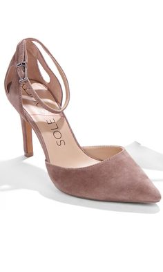 Sumptuous suede heels with an ankle-wrapped shape, adjustable buckle closure and pointed toe.