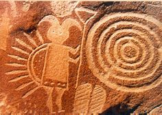 Petroglyphs, Arizona: the Navajo deity called Monsterslayer at Crow Canyon, one of the Hero Twins. This petroglyph was created by the Dinetah, the ancestors of the Navajo people. Largo Canyon, New Mexico.
