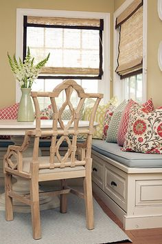 banquette - love the mix of patterns on the pillows and the shades on the windows and the white table
