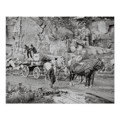 Workers loading blocks of stone onto a wagon at a granite quarry. Concord, New Hampshire. 1908.