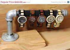 ON SALE Steampunk Pipe and Wood Watch or Bracelet Holders or Display. $34.00, via Etsy.