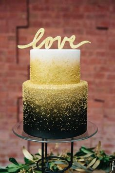Black yellow gold and white fondant glitter buttercream two tier cake with love sign #GlitterCake
