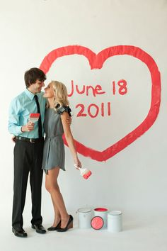 couple-painting-on-wall-save-the-date-photo