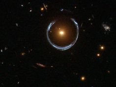 Einstein Ring  The universe is playing horseshoes—thanks to a warping effect of gravity predicted by Einstein.    A newly released picture from the Hubble Space Telescope shows a red, massive galaxy surrounded by a partial blue ring. This cosmic horseshoe is actually a very distant galaxy whose light has been magnified and distorted by the strong gravitational pull of the red galaxy in the foreground.    Such Einstein rings are rare because they require a precise alignment of galaxies, as…