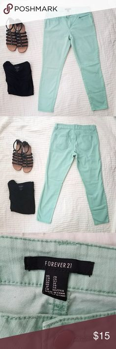 """Forever 21 Mint Skinny Ankle Skimming Jeans Great mint colored jeans in a modern ankle skimming length.  Approx measurements: waist 30,"""" hips 38,"""" inzeam 27.5."""" Forever 21 Jeans Ankle & Cropped"""