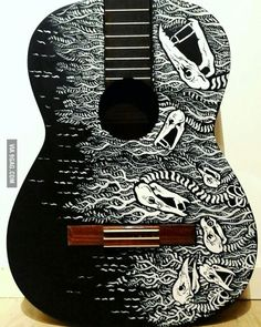 I  decided to paint my acoustic  guitar, lamb of  god themed