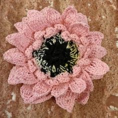 Crochet this beautiful 3D Gerbera Daisy motif to use in a variety of projects! Make a hair clip, a potholder, anything you can imagine! Pattern works with thread or yarn. A SheilaSchnauzies design.
