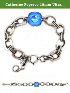 Catherine Popesco 18mm Ultra Blue Swarovski Crystal Silver Plated Link Bracelet Adjustable. Rambling about Paris, Catherine Popesco discovered a treasure trove of stampings and molds - in the old factories and workshops of Paris, many that were created by the artists of the celebrated jewelry period from the 1900-1930's. With her vivid imagination, Catherine uses the invaluable treasures of the French artistic heritage and style to create an exquisite collection of handmade jewelry, which...