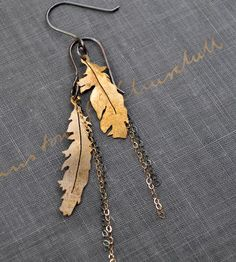 Brass Feather Earrings | An asymmetrical design in brass, silver and gold, these feathe... | Earrings