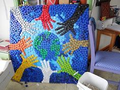 Want to have a bottle cap mural in the media center. Hands Around the World. A bottle cap work of art! Bottle Cap Projects, Bottle Cap Crafts, Plastic Bottle Caps, Plastic Art, Plastic Recycling, Recycled Art Projects, Recycled Crafts, Recycled Magazines, Bottle Top Art
