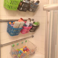 """Finally organized all 7 kids bathroom """"stuff"""". Tension rods with dollar store baskets!! I'm so happy to have nothing in the bathtub!!"""