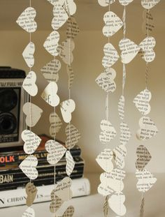Book Page Hearts Wedding Garland, Eco Friendly Garland, Paper Wedding Decorations, Paper Hearts Garland - 10 foot long garland by smileywileys on Etsy https://www.etsy.com/listing/153042881/book-page-hearts-wedding-garland-eco