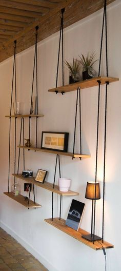 Hanging shelves made from a simple wood planks and cord. #interestinginteriors