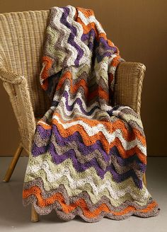 This colorful ripple afghan is the perfect addition to any room. (Lion Brand Yarn)