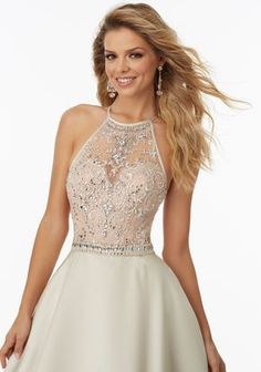 Morilee by Madeline Gardner 99062   Larissa Satin Prom Gown with Beaded Net Illusion Bodice. High Scoop Neckline and Criss Cross Back. Zipper Back Closure. Colors Available: Black/Nude, Champagne/Nude
