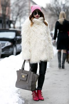 30 Ways to Look Stylish in the Dead of Winter - cozy white fur coat,  bubblegum pink beanie, skinnies and red ankle boots with buckle detail