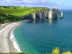 It has been hot in Paris so we decided to visit the Normandy coast. Étretat is best known for its cliffs, including three natural arches and the pointed Vacation Places, Best Vacations, Vacation Destinations, Family Vacations, Vacation Ideas, Etretat France, Falaise Etretat, Images Of France, Station Balnéaire