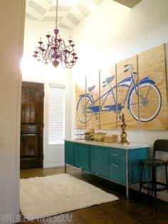 office credenza maybe MCM? wood shop stool and stained carved dark wood door. But really I am stealing this plywood panel art idea.