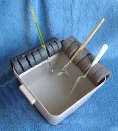 Cut foam pipe insulation to fit sides of container and cut slits in foam for a super easy paint brush holder.