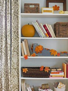 Little touches like these leaves on bookshelves add just the perfect amount of Fall feeling without requiring much space. #partycrafters #fall