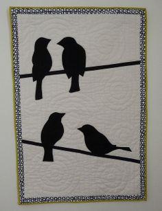 bird wall quilt; wool felt applique and hand quilting.