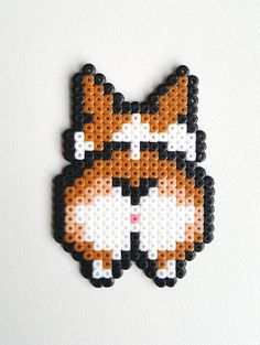 Check out this item in my Etsy shop https://www.etsy.com/listing/524344674/corgi-dog-keychain-magnet-sprite-perler