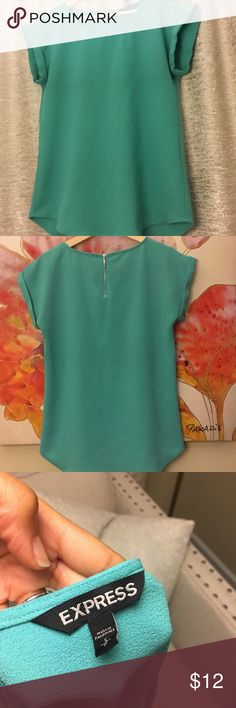 Cute Aqua Top from EXPRESS! Perfect top work work. Looks very professional with or without a blazer! Size Small. Hardly worn! Great condition. Beautiful teal/aqua color. Express Tops Blouses