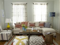 L-shaped sectional. Poufs. Armchair. Small living room layout.
