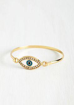 All Eyes On You Bracelet. I spy with my little eyethis gleaming gold bracelet! #multi #modcloth