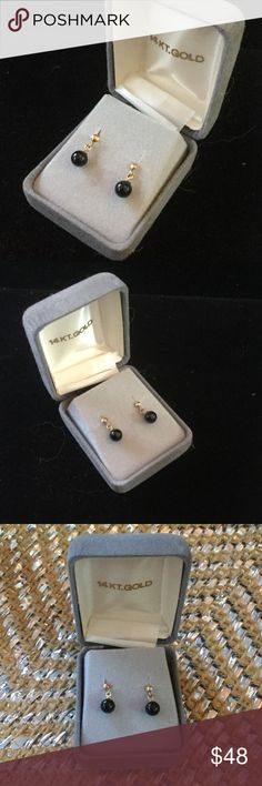 Genuine 14 K Gold Black Onyx Earrings Vintage Genuine 14 K gold and genuine Black Onyx dainty little dangles.  Buy quality,  not at mall jewelry stores where they have a high overhead but here on Posh !  Pieced and 14 K gold to last several lifetimes.  Original vintage box too Vintage Estate Jewelry Earrings
