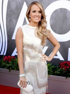 Carrie Underwood, Presenter at the 2014 ACM Awards, is wearing David Yurman's rose quartz pebble and diamond earrings, a diamond pavé twist rounded bangle, a diamond pavé hinged cuff and a diamond bangle with cable outside.