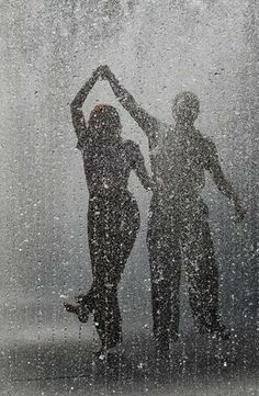 "dancing in the rain...""What we find in a soulmate is not something wild to tame but something wild to run with."" ~Robert Brault"