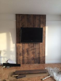 Wood wall, stained floor color and grey wash to antique it! Wood wall, stained floor color and grey wash to antique it! Tv Wall Decor, Wooden Wall Decor, Wooden Walls, Wall Wood, Mounted Tv Decor, Wall Mounted Tv, Deco Tv, Tv Wall Cabinets, Hide Wires
