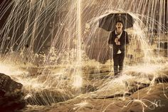 Took some photos today of my friend, an umbrella, and steel wool on fire. - photograph by Josell Mariano