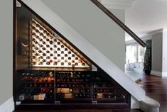 The Best Wine Cabinets, Wine Rooms And Wine Storage Under Stairs is part of Wine cabinet Ideas - Who said you need a wine cellar to create a gorgeous wine display We've scouted around for some clever wine storage cabinets and bespoke designs Wine Glass Rack, Wine Rack Wall, Wine Wall, Cabinet Under Stairs, Room Under Stairs, Wine Cellar Modern, Wine Cellar Design, Wine Design, Under Stairs Wine Cellar